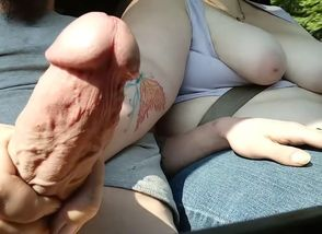Boobies out, on the road handjob.