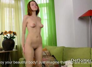 Sumptuous red-haired young woman..