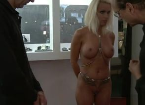 Huge-chested strapped blond..